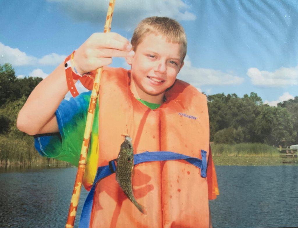 Timmy fishing at camp